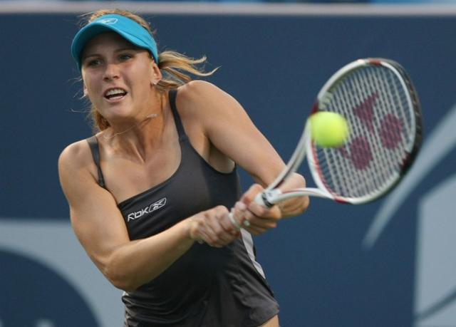 Nicole Vaidisova hits a two-handed backhand.jpg