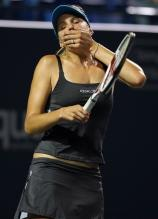 Nicole Vaidisova covers her mouth.jpg