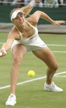 Nicole Vaidisova stretches to hit a defensive forehand.jpg