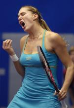 Nicole Vaidisova in blue tennis outift is not happy.jpg