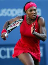 Serena Williams sticks out tongue at goes after a ball at the US Open.jpg