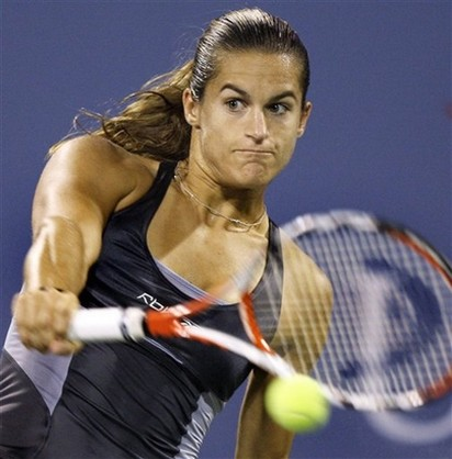 Amelie Mauresmo hits a one handed backhand during the US ...