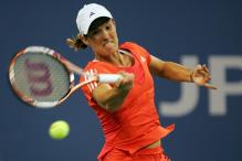 justine henin forehand after contact.jpg