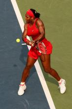 Serena Williams hits a backhand inside the baseline.jpg