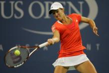 justine henin forehand at contact.jpg