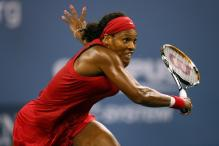 Serena Williams runs up to hit a backhand volley.jpg