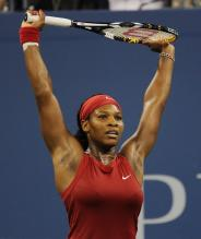 Serena Williams stretches her arms.jpg