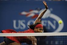 Serena Williams stretches to hit a forehand volley winner during the 2008 US Open championship final.jpg
