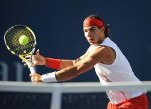 Rafael Nadal hits a backhand volley.jpg