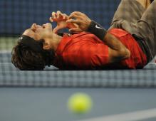 Roger Federer falls to the ground in celebration of his US Open 2008 championship.jpg