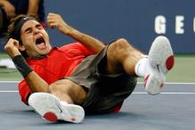 Roger Federer rolls to the ground in happiness.jpg