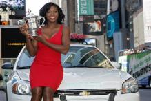 Serena Williams poses with her US Open 2008 trophy in a red dress.jpg