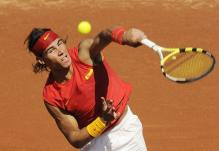 Rafael Nadal service motion right after hitting the ball.jpg