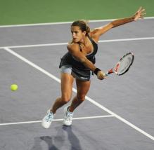 Amelie Mauresmo goes for a backhand volley.jpg
