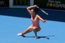 Jelena Jankovic goes down low to spin a forehnad.jpg