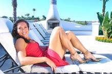 Jelena Jankovic in a red summer dress on a lounge chair.jpg
