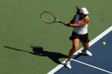 marion bartoli two-handed forehand before contact.jpg