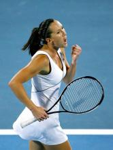 Jelena Jankovic in a white outfit celebrates a point.jpg