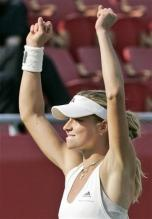 Maria Kirilenko raises her arms in celebration.jpg