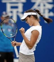 Ana Ivanovic celebrates a point with a fist pump at the China Open 2008.jpg