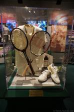 Wimbledon racquets & tennis shoes & jacket display at International Tennis Hall of Fame.jpg