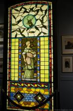 Stained glass window of Woman holding racquet and ball at International Tennis Hall of Fame & Museum.jpg