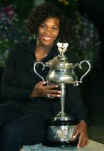 Serena Williams in black outfit poses with her Australian Open 2009 Trophy.jpg