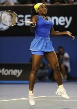 Serena Williams jumps up to hit a forehand during the 2009 Australian Open.jpg