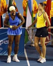 Serena Williams and Dinara Safina have a laugh during the Australian Open 2009 trophy presentation.jpg