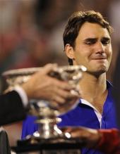 Roger Federer cries as he sees Nadal get handed the 2009 Australian Open Championship trophy.jpg