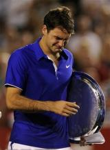 Roger Federer can't hide his emotions during the awards ceremony of the 2009 Australian Open.jpg