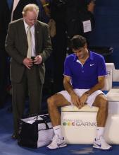 Roger Federer is consoled by Rod Laver after losing the 2009 Australian Open Championship match.jpg