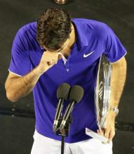 Roger Federer is choked up as he speaks in the mike after losing the Australian Open Championship match to Nadal.jpg