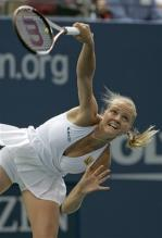 agnes szavay serve follow-through.jpg