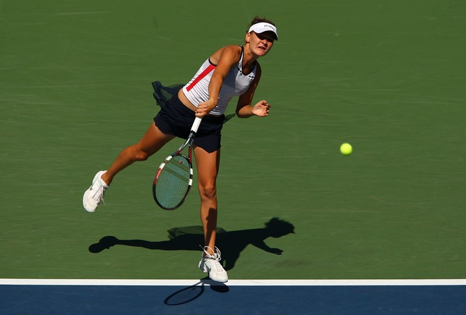 agnieszka radwanska serve follow-through.jpg