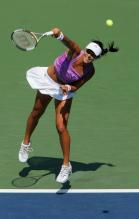 ana ivanovic serve after contact.jpg