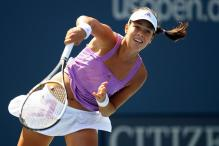 ana ivanovic serve follow through.jpg