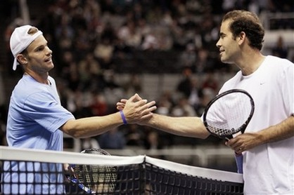 Andy Roddick shakes hands with Pete Sampras before their exhibition match in 2009.jpg