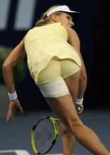Elena Dementieva in a yellow outfit shows tight bum.jpg