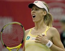 Elena Dementieva in a yellow top reacts.jpg