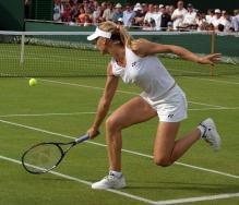 Elena Dementieva hits a backhand slice at Wimbledon.jpg