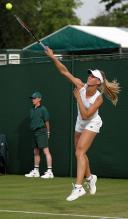 Elena Dementieva hits a serve at Wimbledon.jpg