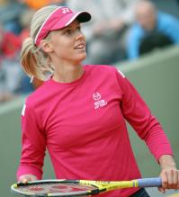 Elena Dementieva in a pink visor and sweatshirt.jpg