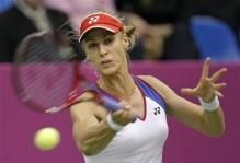 Elena Dementieva strikes a forehand in Fed Cup 2009 Play.jpg