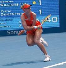The muscular Elena Dementieva catches her balance after hitting a shot at the Australian Open 2009.jpg
