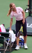 Elena Dementieva sticks out her tongue after a victory.jpg