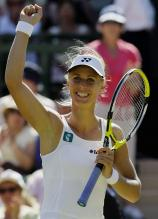 Elena Dementieva raises her hand in celebration.jpg