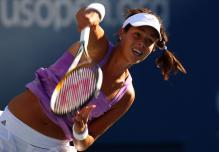 anna ivanovic serve follow-through.jpg