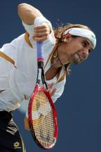 david-ferrer-serve-follow-through.jpg