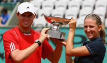 Victoria Azarenka holds the doubles championship trophy with Bob Bryan.jpg